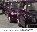 Small photo of Taxi cars on street