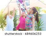 three asian kids flying kite... | Shutterstock . vector #684606253