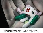 Small photo of Health care and Risk of death from accidental overdose concept,soft focus Hand holding a dice and pill and capsule,vintage style.