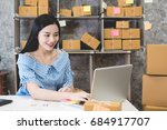 calculating the cost of postage ... | Shutterstock . vector #684917707