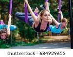 Young Women  Antigravity Yoga...