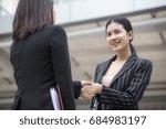 asian businesspeople shaking... | Shutterstock . vector #684983197