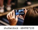 girl shoots video to smartphone ... | Shutterstock . vector #684987133