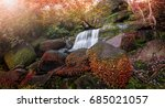 waterfall in autumn forest at... | Shutterstock . vector #685021057