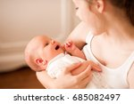 smiling mother holding small... | Shutterstock . vector #685082497