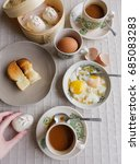 Small photo of During the colonial days,Chinese coffee shops are mostly run by Hailanese / Retro Coffee Shop Breakfast / Usual toasted or steamed bread with kaya spread and cold butter,half boiled eggs or even bao