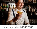 close up smiling barman with... | Shutterstock . vector #685352683