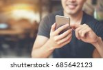 happy male using smartphone at... | Shutterstock . vector #685642123