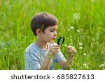 young boy exploring nature in... | Shutterstock . vector #685827613