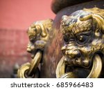 Small photo of Closeup of lion ornamentation in Forbidden City, Beijing China