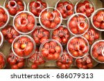 red cherry tomatoes in plastic... | Shutterstock . vector #686079313