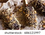 ice cream popsicles with nut on ... | Shutterstock . vector #686121997