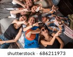 three friends pointing at... | Shutterstock . vector #686211973