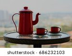 Red Teapot And Metal Cups In A...