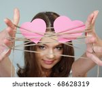 the beautiful girl holds two...   Shutterstock . vector #68628319