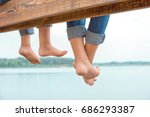 two brothers swung their legs... | Shutterstock . vector #686293387