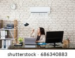 young businesswoman operating... | Shutterstock . vector #686340883