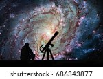 Man With Telescope Looking At...
