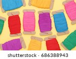 spool of threads on yellow... | Shutterstock . vector #686388943