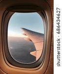Small photo of Window airplane sunset