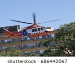 Small photo of Air ambulance takes off from hospital roof.