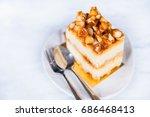 macadamia cheesecake on white... | Shutterstock . vector #686468413