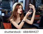 a woman with red lips takes... | Shutterstock . vector #686484427