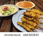 pork satay  or barbecue pork on ... | Shutterstock . vector #686582833
