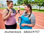 laughing fat friendly women in...   Shutterstock . vector #686619757
