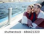 cheerful couple wrapped in... | Shutterstock . vector #686621323
