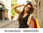 young woman shopping outdoor | Shutterstock . vector #686643283