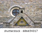 Small photo of All-seeing eye - a mosaic of wall background medieval