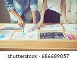 teamwork helps us select the... | Shutterstock . vector #686689057