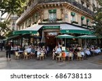 Small photo of Paris, France-JULY 25,, 2017 : the famous cafe Les deux Magots located in Saint Germain des Pres area of Paris.It has been frequented by Ernest Hemingway, Pablo Picasso,Albert Camus, James Joyce...