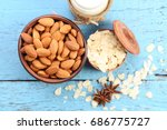 almonds in bowl with bottle of...   Shutterstock . vector #686775727