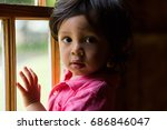 ethnic toddler leaning on a... | Shutterstock . vector #686846047