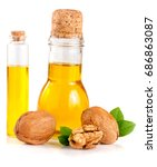 Small photo of Walnut oil with nuts isolated on a white background