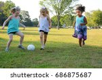 three little girls playing ball ...   Shutterstock . vector #686875687