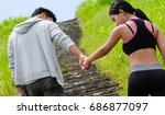 lovely sporty couple holding... | Shutterstock . vector #686877097