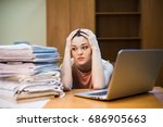 a young woman sits in front of... | Shutterstock . vector #686905663