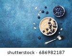 bowl of oatmeal porridge with... | Shutterstock . vector #686982187
