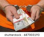 hands of a man in handcuffs... | Shutterstock . vector #687003193
