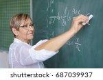 senior female teacher writing... | Shutterstock . vector #687039937