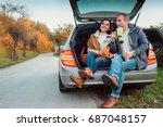 tea party in car trunk   loving ... | Shutterstock . vector #687048157