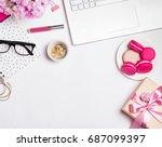 modern feminine workplace. girl ... | Shutterstock . vector #687099397