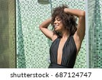 cheerful young african woman... | Shutterstock . vector #687124747