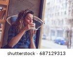 beautiful young woman sitting...   Shutterstock . vector #687129313