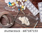 hard drugs and handcuffs. drug... | Shutterstock . vector #687187153