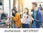 happy friends having barbecue... | Shutterstock . vector #687199207