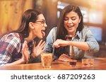 joyful girls making faces while ... | Shutterstock . vector #687209263